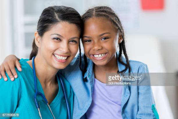 Confident pediatrician with young patient