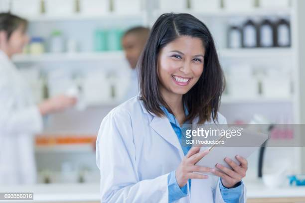 Confident pharmacist at work
