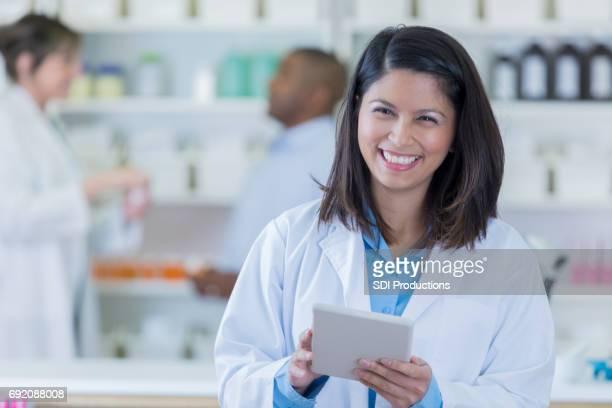 Confident pharmacist in pharmacy