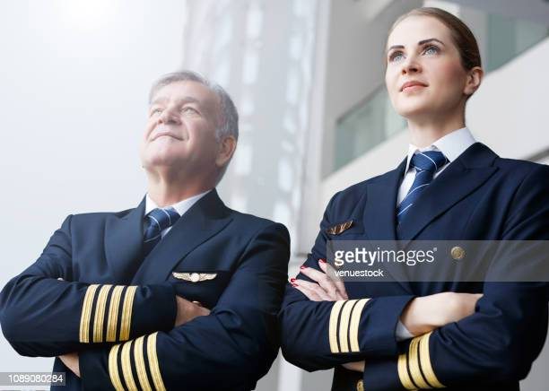 confident pilots looking through the window - piloting stock pictures, royalty-free photos & images