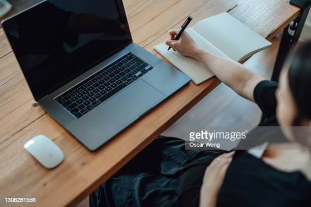 confident pregnant woman working at home with laptop - unrecognisable person stock pictures, royalty-free photos & images