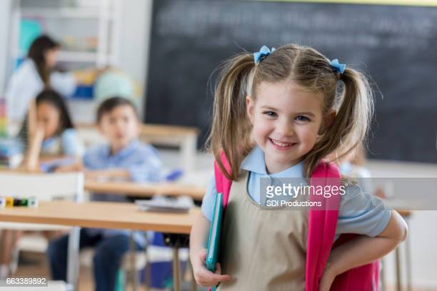 confident preschooler in her classroom - school building stock pictures, royalty-free photos & images