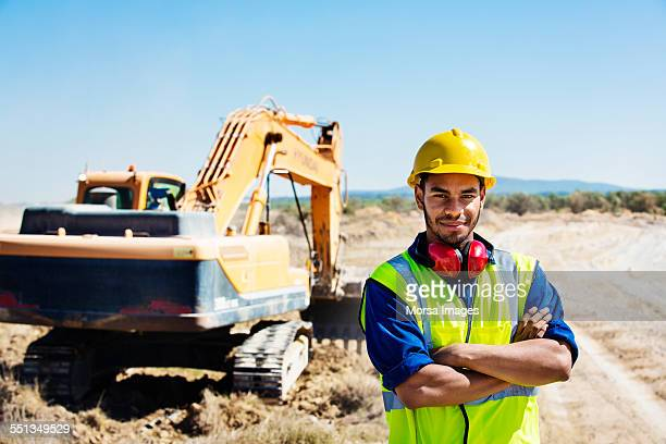 Confident quarry worker standing at site