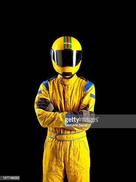 Confident racing driver with crossed arms