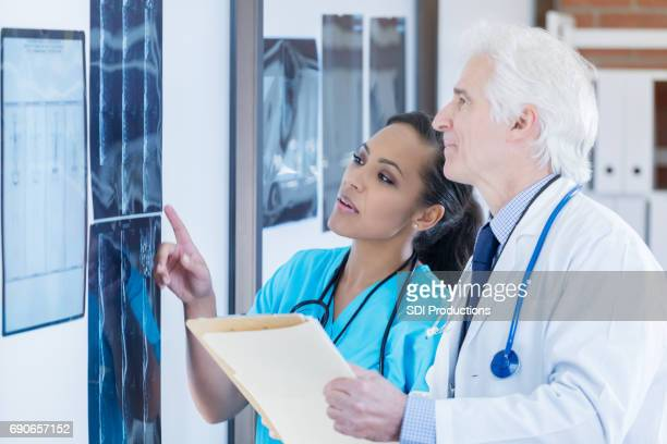Confident radiologists examine patient x-rays