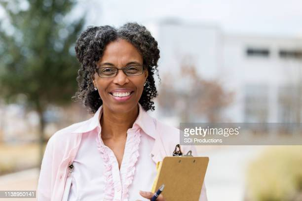confident school teacher - school principal stock pictures, royalty-free photos & images