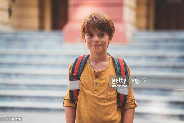 confident schoolboy at his first day in school - boys stock pictures, royalty-free photos & images