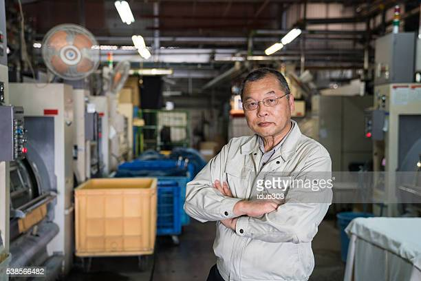 Confident senior industry manager in his textile factory
