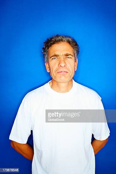 Confident senior man in white t-shirt