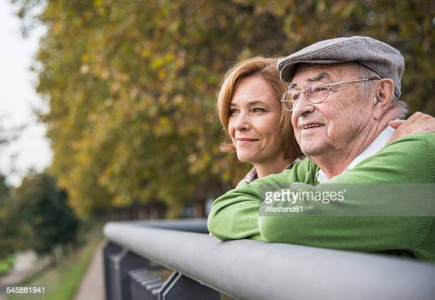 confident senior man with daughter outdoors - adult offspring stock pictures, royalty-free photos & images