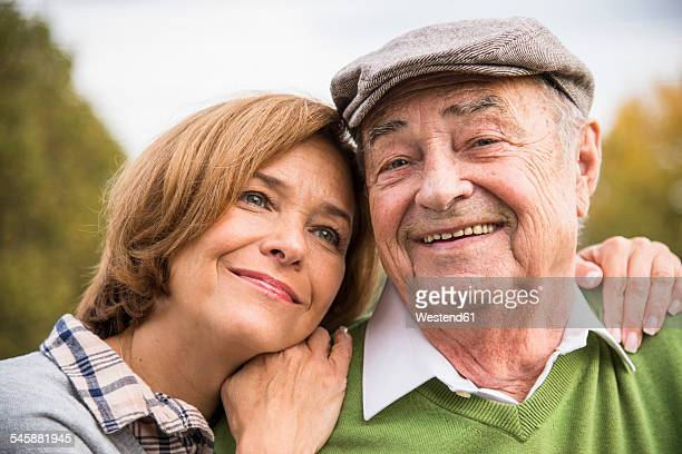 Confident senior man with daughter outdoors