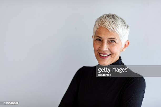 confident senior woman - gray hair stock pictures, royalty-free photos & images