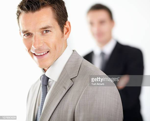 confident smart businessman with colleague - number of people stock photos and pictures