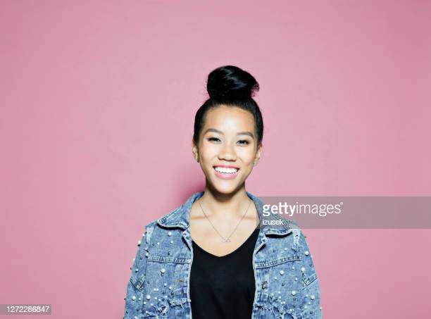 confident smiling businesswoman on pink background - casual clothing stock pictures, royalty-free photos & images