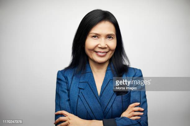 confident smiling mature executive in blazer - blue blazer stock pictures, royalty-free photos & images