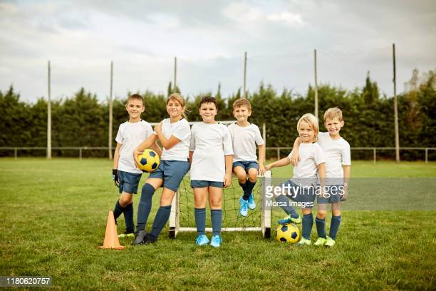 confident soccer players on training field - children only stock pictures, royalty-free photos & images