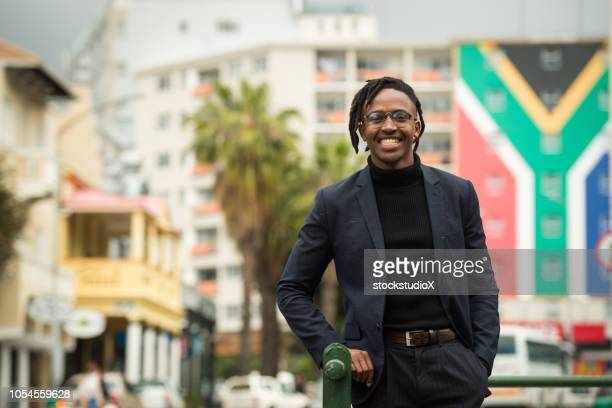 confident south african man - south african flag stock photos and pictures