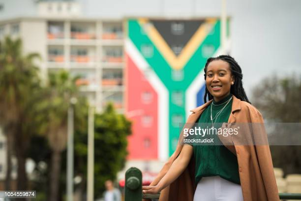 confident south african woman - south african flag stock photos and pictures
