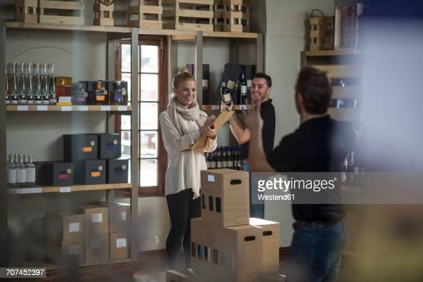Confident staff in wine shop