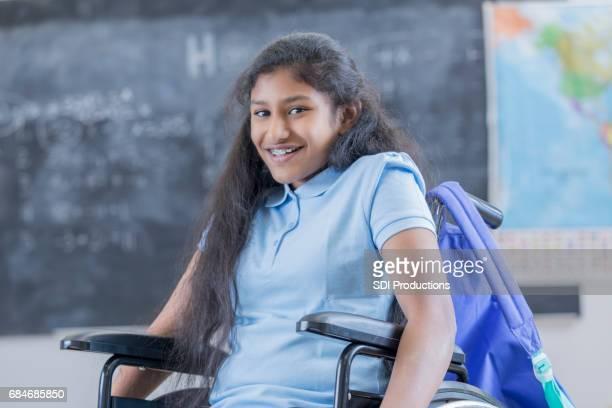 Confident STEM schoolgirl in wheelchair at school