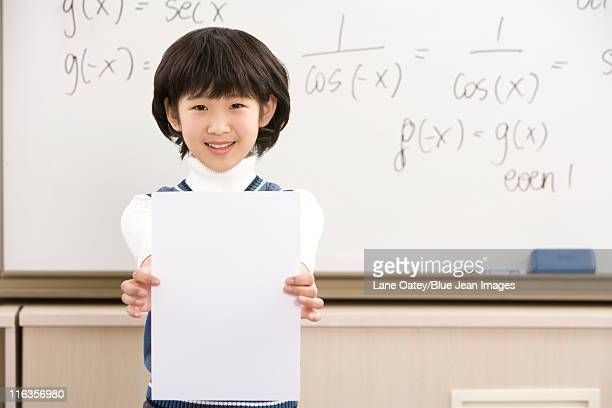 Confident student standing in front of math work