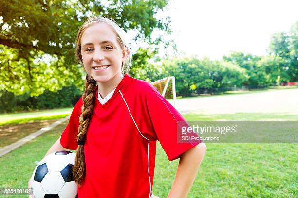 Confident teen soccer player