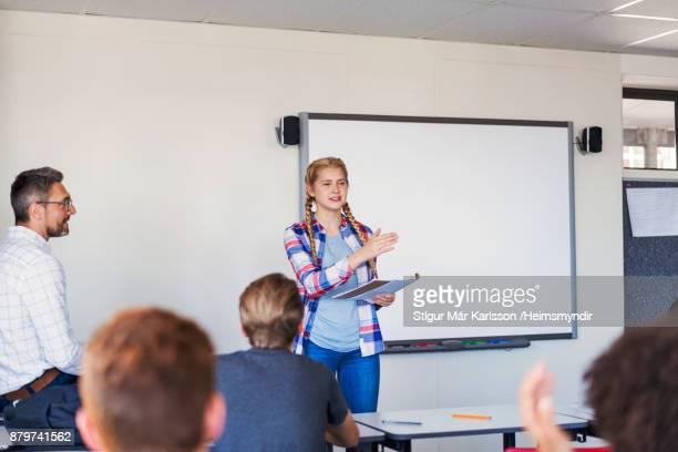 Confident teenage girl giving presentation