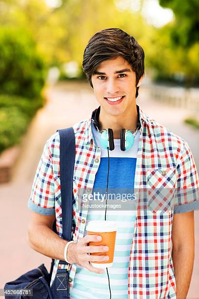 Confident Teenage Student Holding Disposable Cup On Campus