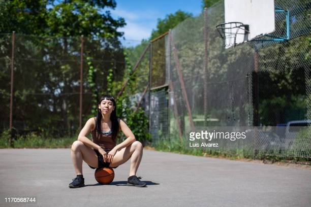 confident woman basketball player on court - gray shoe stock pictures, royalty-free photos & images