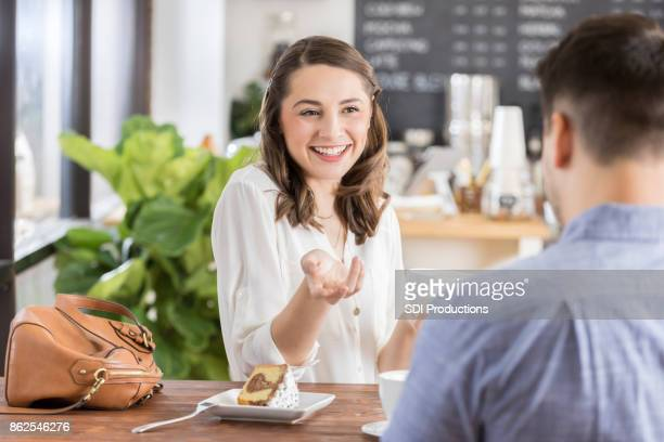 Confident woman gestures while talking with boyfriend