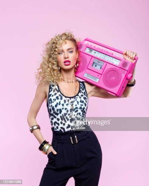 confident woman in 80's style outfit holding boom box - jewellery stock pictures, royalty-free photos & images