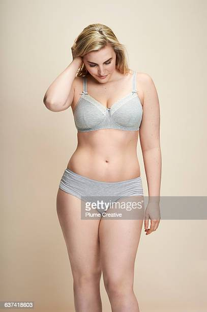 Confident woman in underwear