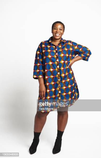 confident woman looking at camera - dress stock pictures, royalty-free photos & images