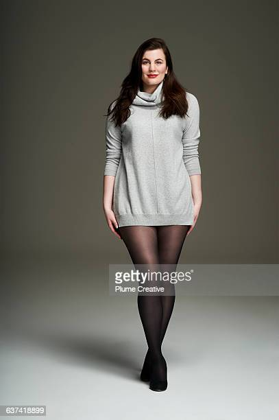 confident woman looking to camera - beautiful women in pantyhose stock photos and pictures