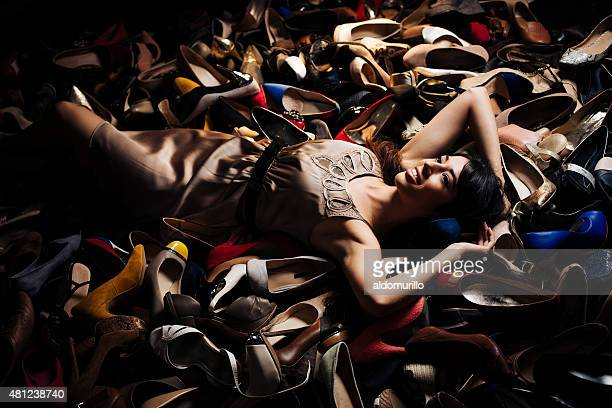 Confident woman lying on high heels