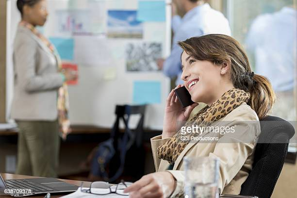 Confident woman on a business call