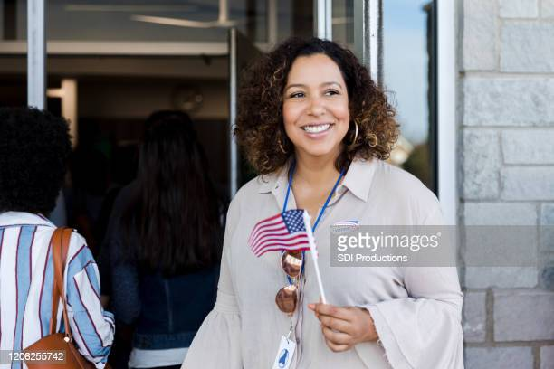 confident woman on election day - citizenship stock pictures, royalty-free photos & images