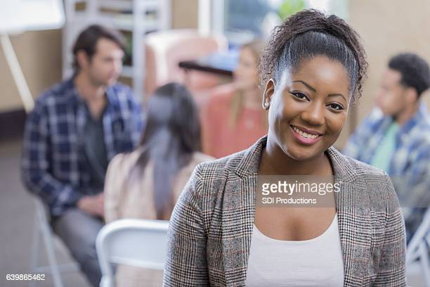 confident woman prepares to participate in group therapy session - book club meeting stock pictures, royalty-free photos & images