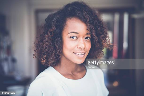 Confident woman smiling at home