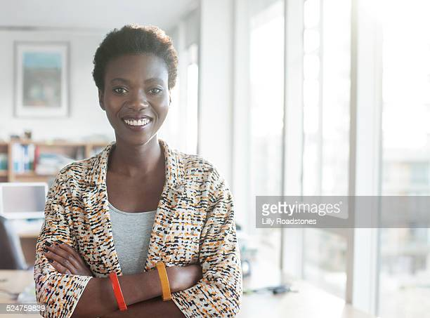 Confident woman standing in workplace