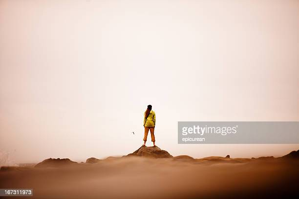 Confident woman standing on the edge of ocean