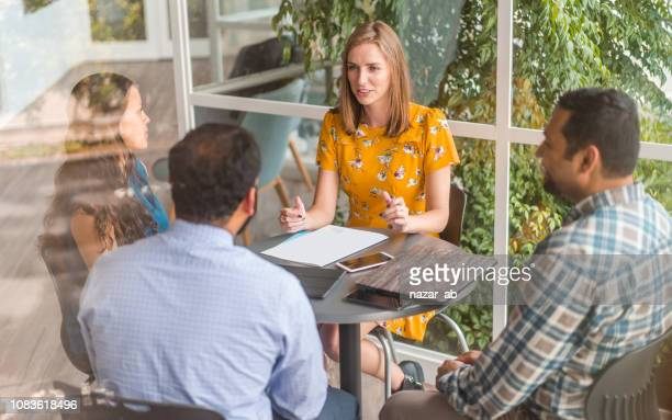 confident woman taking lead in business meeting. - smart casual stock pictures, royalty-free photos & images
