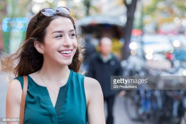 Confident woman tours New York City