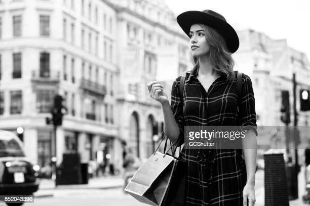 Confident woman walking the busy streets of London