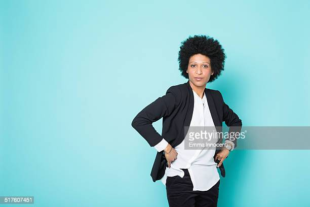 confident woman with afro, white shirt and jacket - black jacket stock pictures, royalty-free photos & images