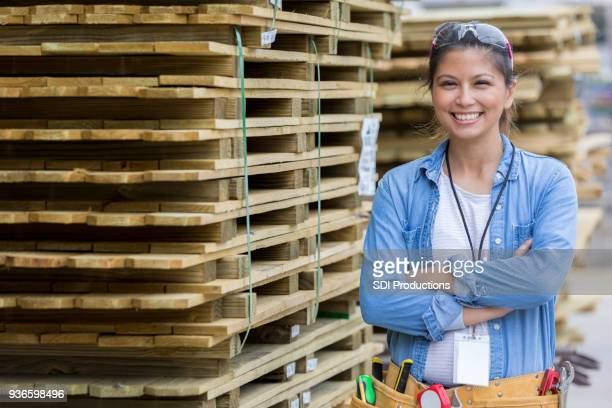 Confident woman working in home improvement store