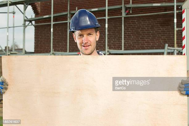 Confident worker presenting empty board.