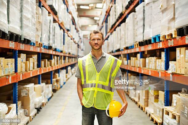 Confident worker standing at warehouse