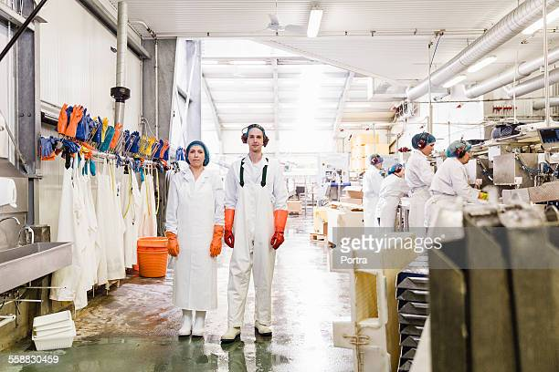 Confident workers standing in fishing industry