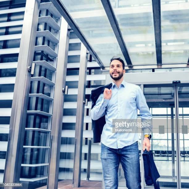 confident young businessman at business center - quitting a job stock pictures, royalty-free photos & images
